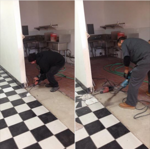 Jerry and Mak removing tile in the Dairy Room